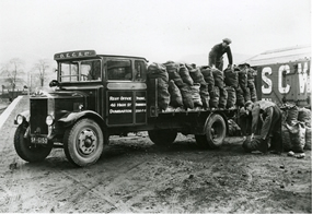 Coal Sacks being loaded onto a Dumbarton Equitable Coal Society Truck